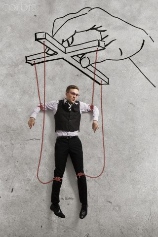 Businessman dangling on threads